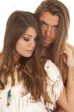 Couple long hair man behind Native American woman close Royalty Free Stock Photography