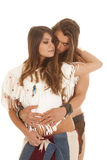 Couple long hair man behind Native american woman eyes closed. A Native American women with her eyes closed being held by her American man Stock Photography