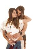 Couple long hair man behind Native american woman eyes closed Stock Photography