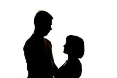 Couple look at each other- Silhouette. Isolated on white Royalty Free Stock Images