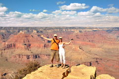 Couple look out on the Grand Canyon Royalty Free Stock Photo