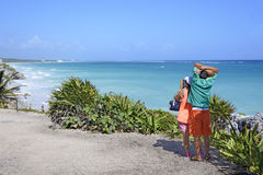 Couple look out over the Caribbean Sea in Tulum, Yucatan Peninsula, Mexico Stock Images