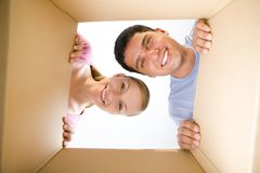 Couple lookin into box Royalty Free Stock Images