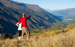 Couple Looking Afar Where The Mountain Lake Concept Royalty Free Stock Photos