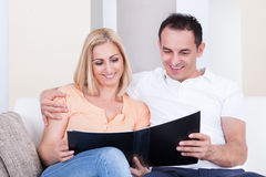 Couple Looking At Album Royalty Free Stock Images