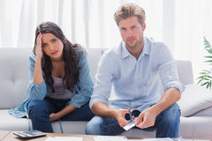 Couple looking anxious while doing their accounts. Together in the living room royalty free stock photos