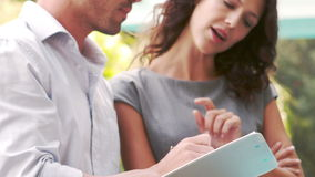 Couple looking around new home stock footage