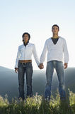 Couple Looking Away While Holding Hands At Park Royalty Free Stock Images
