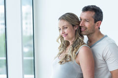 Couple looking away and smiling Stock Photos