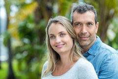 Couple looking away and smiling Stock Photo