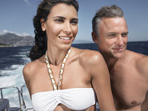Couple Looking Away On Yacht Stock Photos