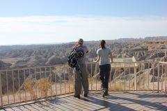 Couple looking at badlands canyon stock image