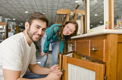 Couple looking bath furniture at big store Royalty Free Stock Photography