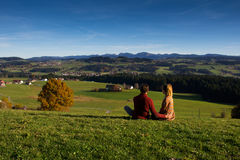Couple looking at beautiful autumn landscape from Bavaria Germany Royalty Free Stock Image