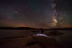 Couple looking at Beautiful Milky Way Royalty Free Stock Photography