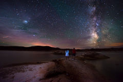 Couple looking at Beautiful Milky Way Stock Image