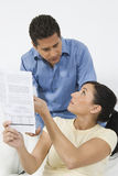 Couple Looking At Bills Royalty Free Stock Image