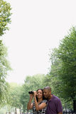 Couple looking through binoculars Stock Photo