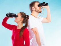 Couple looking through binoculars Stock Photo