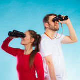 Couple looking through binoculars Royalty Free Stock Images