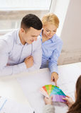 Couple looking at blueprint and color samples Royalty Free Stock Photography