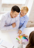 Couple looking at blueprint and color samples Royalty Free Stock Photos