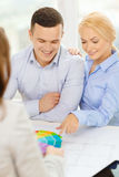 Couple looking at blueprint and color samples Royalty Free Stock Photo