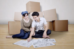 Couple looking at blueprint of new house. On white background Stock Photo