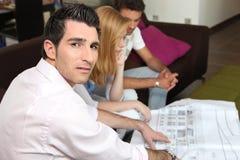 Couple looking at a blueprint Stock Photos