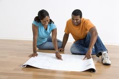 Couple looking at blueprints. stock image