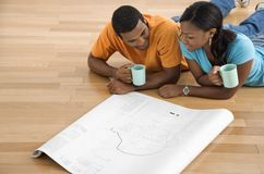 Couple looking at blueprints. Royalty Free Stock Images