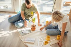 Couple looking blueprints of they new house. Planning interior design stock image