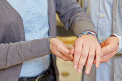 Couple looking for bracelet Royalty Free Stock Photo