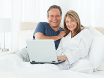 Couple looking at the camera at home Stock Photos