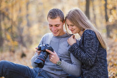 Couple looking into the camera Royalty Free Stock Photo