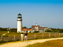 Couple Looking at a Cape Cod Lighthouse Stock Photography