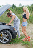 Couple looking at the car engine. royalty free stock image