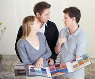 Couple looking at carpet samples Royalty Free Stock Image