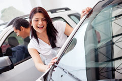 Couple looking at cars Stock Photo