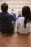 Couple looking at cell phones Royalty Free Stock Photography