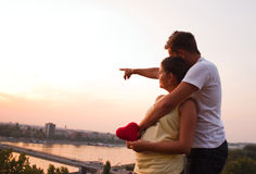 Couple looking at the city. He is showing her the town Royalty Free Stock Photo