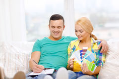 Couple looking at color samples in new home Stock Photo