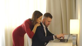 Couple looking at computer stock footage