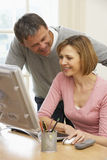 Couple Looking At Computer Screen Royalty Free Stock Photography