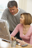 Couple Looking At Computer Screen Royalty Free Stock Photo
