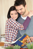 Couple looking cookbook Stock Photo