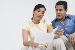 Couple Looking At Credit Card Bill Stock Photos