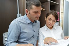 Couple looking at design layout. Home stock image