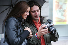 Couple looking digital photos Royalty Free Stock Photos