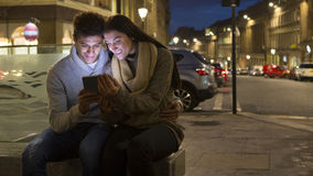 Couple looking at digital tablet in the city Stock Image
